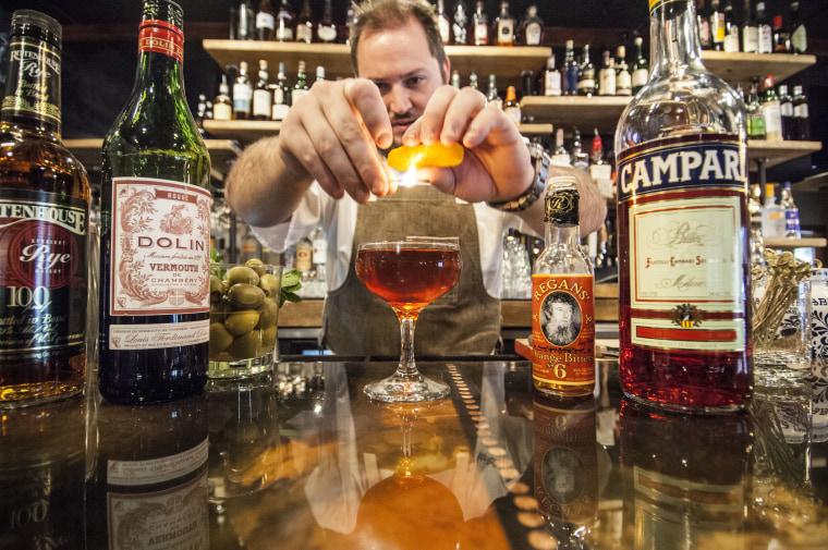 Clayton Rollison mixes a drink. Photo by Michael Hrizuk Photos.