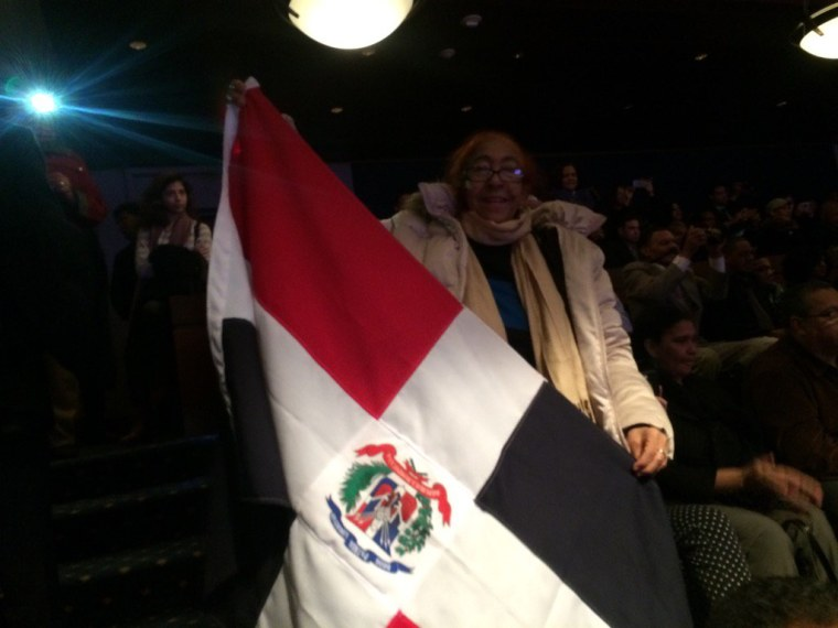 Justiliana Calderon, 72, waves a Dominican flag to celebrate the swearing in of the first Dominican American congressman, Adriano Espaillat (D-NY).