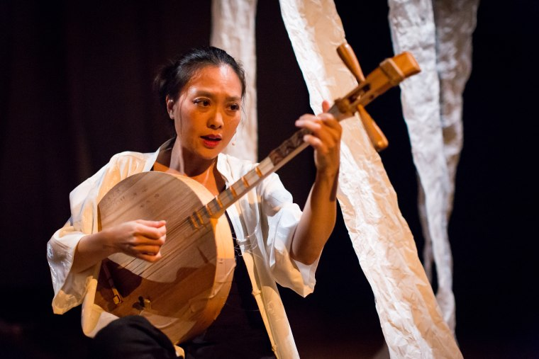"Experimental vocalist, composer, multi-instrumentalist, and dancer Jen Shyu performing ""Solo Rites: Seven Breaths"" at the Asia Society of Texas."