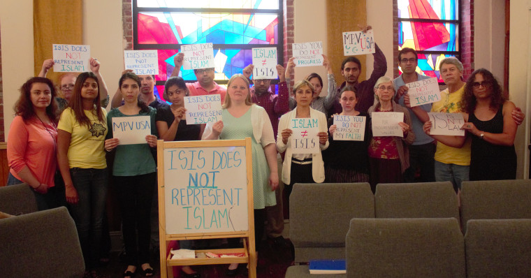 Attendees at a 2016 Muslim for Progressive Values event in New York holding signs stating that ISIS does not represent Islam.