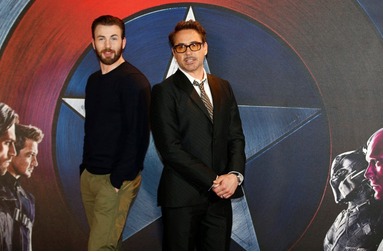 """Image: Actors Chris Evans and Robert Downey Jr pose for photographers at a media event ahead of the release of \""""Captain America: Civil War\"""", in London"""