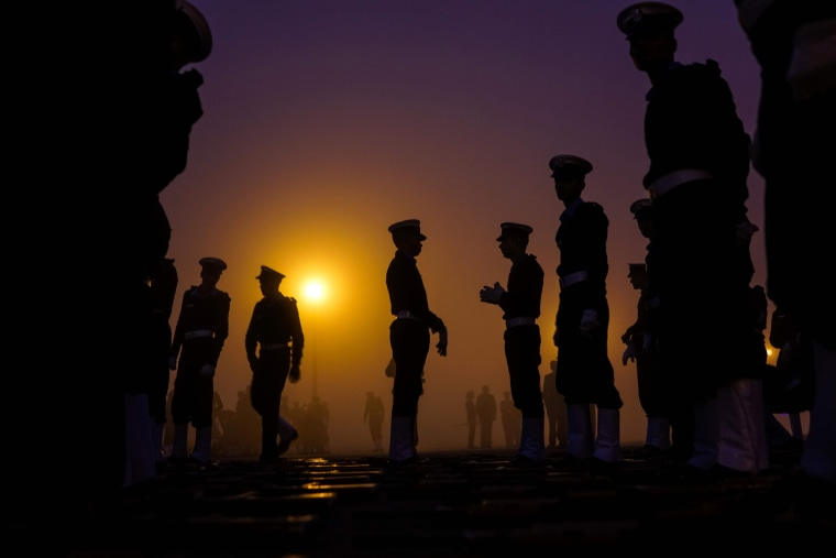 Image: Indian military personnel prepare to march as they rehearse for the forthcoming Republic Day parade