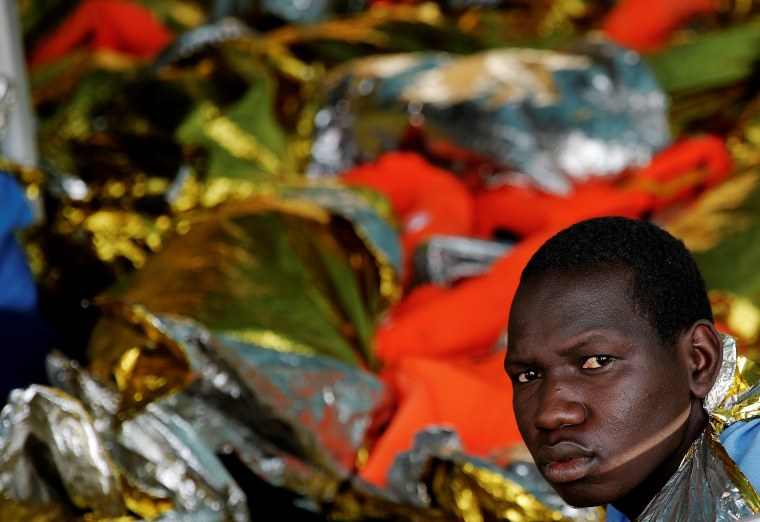 Image: A migrant looks on onboard the former fishing trawler Golfo Azzurro after he was rescued along with other migrants by the Spanish NGO Proactiva Open Arms as the raft he was on drifted out of contol in the central Mediterranean Sea