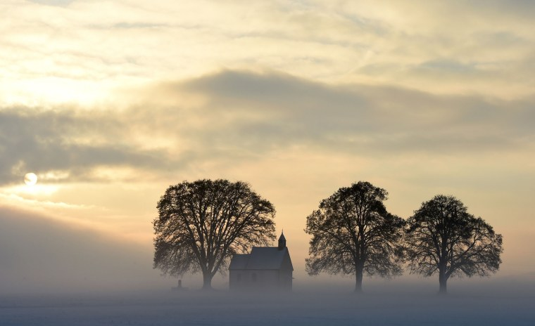 Image: Fog surrounds a small church not far from the small Bavarian village Apfeltrach
