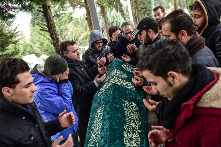 Image: People pray next to the coffin of Mohamed Elhot, one of the victims of the Reina night club attack, during his funeral ceremony on Jan. 3, 2017 in Istanbul.
