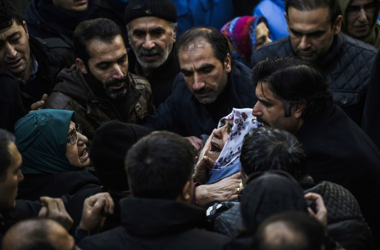 Image: Relatives of security member Fatih Cakmak, 35, who died in the Reina night club attack, mourn during the funeral ceremony on Jan. 2, 2017 in Istanbul.