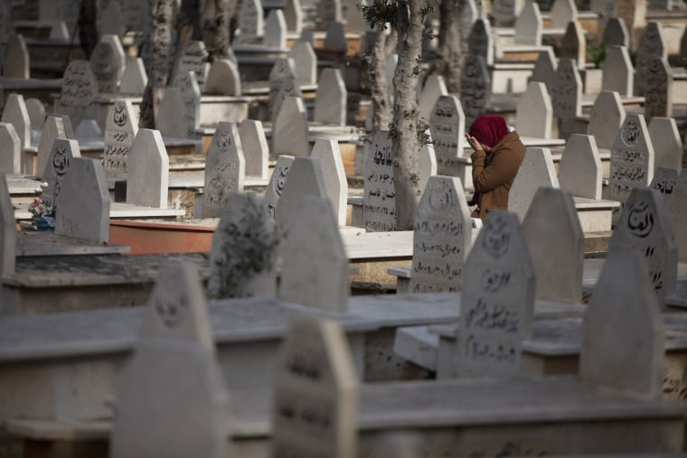 Image: A woman cries inside the cemetery during the funeral of Arab Israeli Leanne Nasser on Jan. 3, 2017 in Tira, Israel.