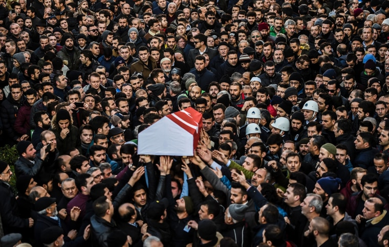 Image: People carry the coffin of Yunus Gormek, 23, one of the victims of the Reina night club attack, during his funeral ceremony on Jan. 2, 2017 in Istanbul.