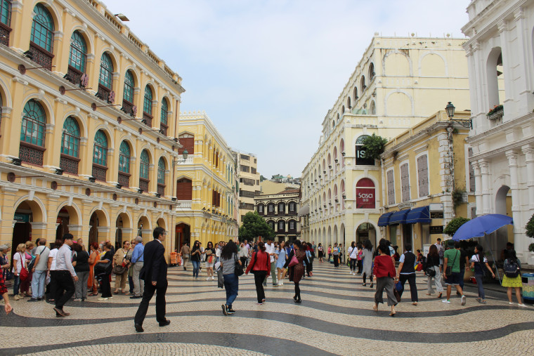 Senado Square in Macao, a UNESCO World Heritage site, with tiled walks, Portuguese-styled government buildings and designer shopping.