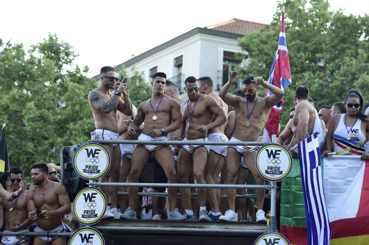 Image: Revelers ride a float during the Gay Pride Parade in Madrid