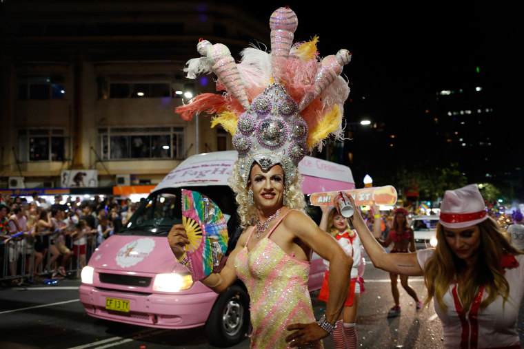 Image: Parade goers celebrate during the Sydney Gay & Lesbian Mardi Gras Parade