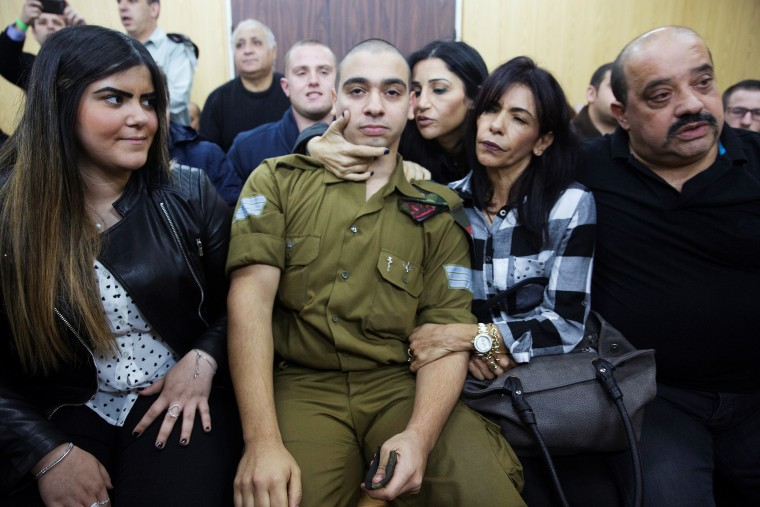 Image: Israeli soldier Elor Azaria, who is charged with manslaughter by the Israeli military, sits to hear his verdict in a military court in Tel Aviv, Israel