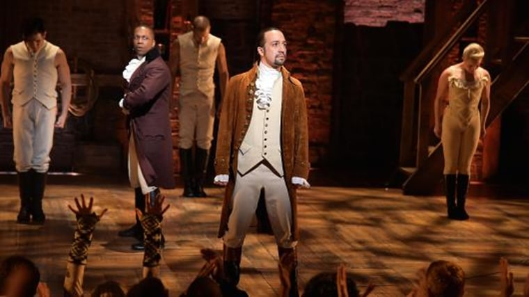 Actor Leslie Odom, Jr. (L) and actor, composer Lin-Manuel Miranda (R) and cast of 'Hamilton' perform on stage during 'Hamilton.' Theo Wargo | WireImage | Getty Images