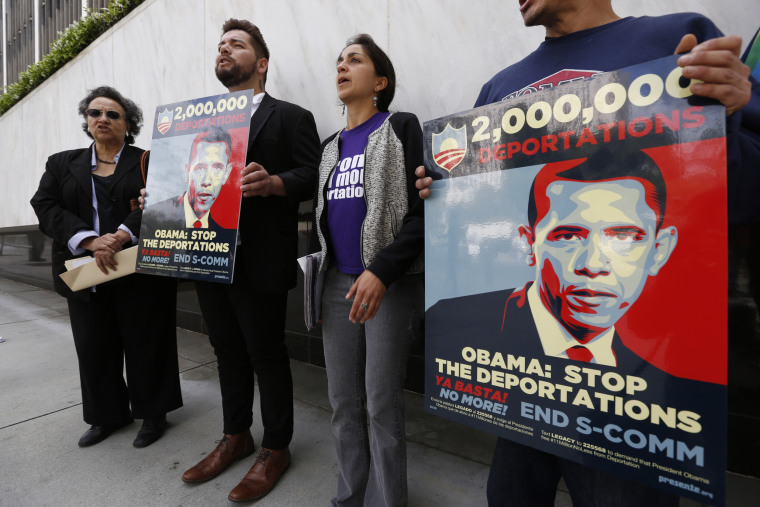 """Members of a coalition of Latino groups rally outside the Federal Building in Los Angeles on March. 26, 2014. The rally was part of the """"Obama Legacy Project,"""" a campaign looking to hold President Obama accountable for record deportations."""