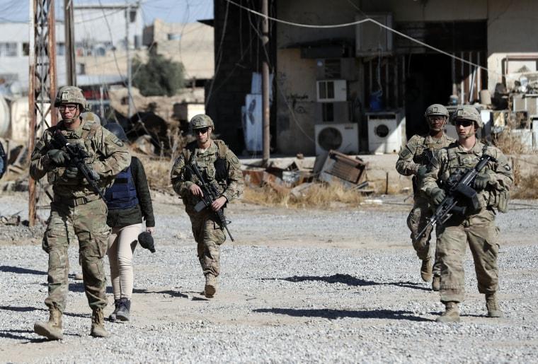 Image: U.S. soldiers patrol near an Iraqi army base