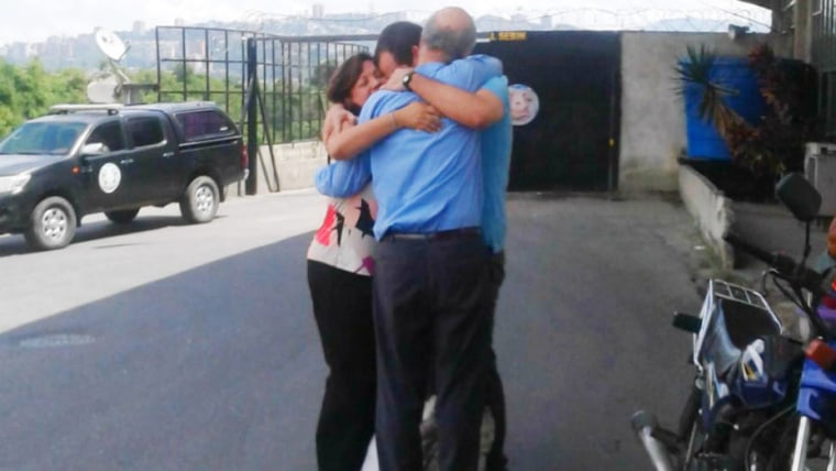 Venezuelan activist and lawyer Francisco Marquez hugs his parents for the first time after being released from the SEBIN prison on October 18, 2016 in Caracas, Venezuela.