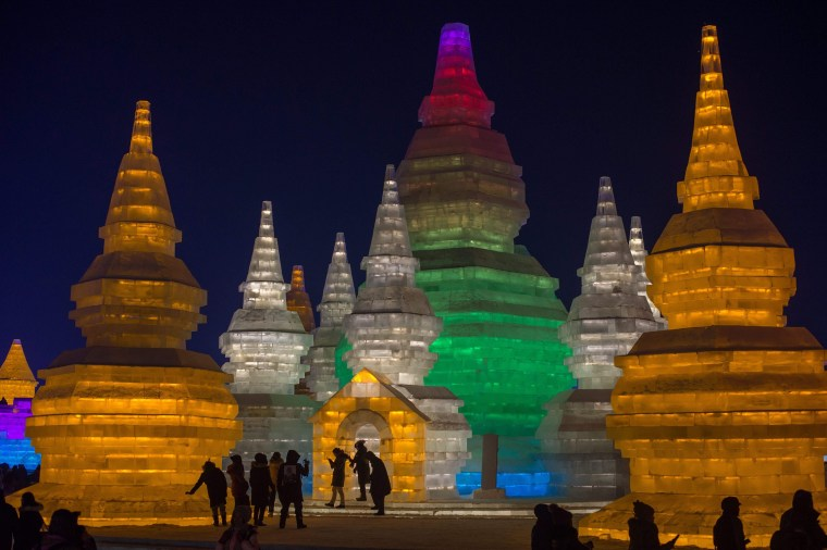 Image: People visit ice sculptures illuminated by colored lights at the Harbin Ice and Snow Festival to celebrate the new year in Harbin, China on Jan. 4.