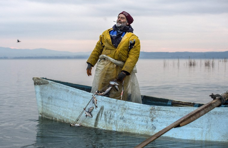 Image: A fisherman pulls a fishing net from the Dojran lake in Djordan, the former Yugoslav Republic of Macedonia on Jan. 4.