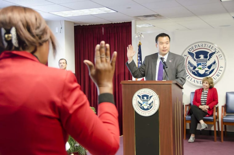 Shin Inouye swearing in new citizens at a naturalization ceremony.