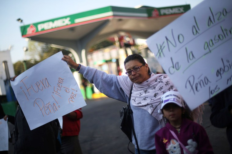 Image: Protesters block the entrance to a gas station as they take part during a demonstration against the rising prices of gasoline enforced by the Mexican government at Tlalpan Avenue in Mexico City on Jan. 3.