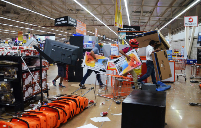Image: Dozens of people loot shops during an alleged protest against the increase in the gas prices, in the port of Veracruz, Mexico on Jan. 4.