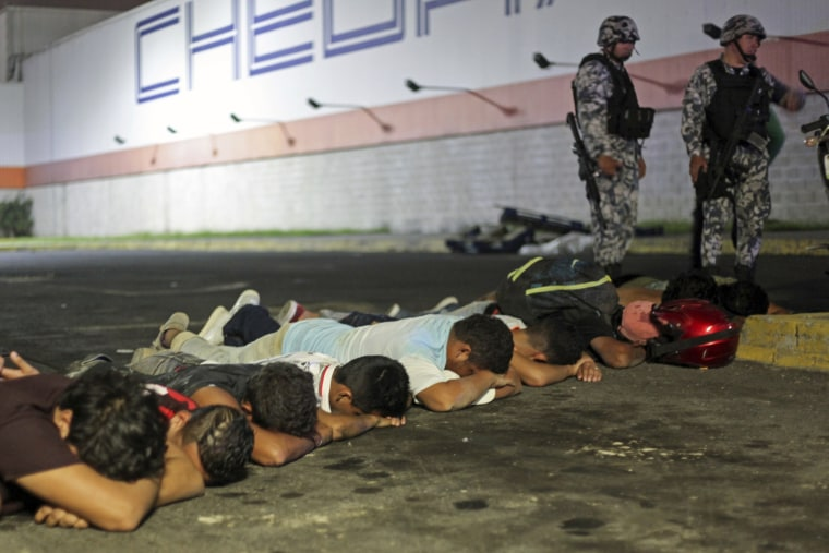 Image: Suspects are detained by navy police after a store was ransacked by a crowd in the port of Veracruz, Mexico on Jan. 4.