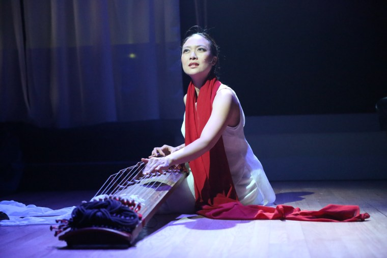 "Experimental vocalist, composer, multi-instrumentalist, and dancer Jen Shyu performing ""Song of Silver Geese,"" a multilingual, ritual music drama composed for her band Jade Tongue, dancer Satoshi Haga, and Mivos Quartet."