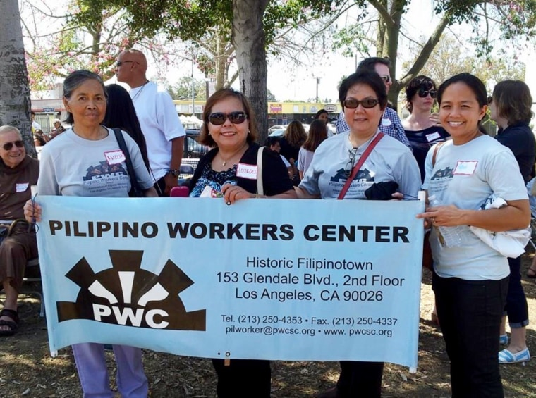 Emily Uy, third from left, at an event for the Pilipino Workers Center.