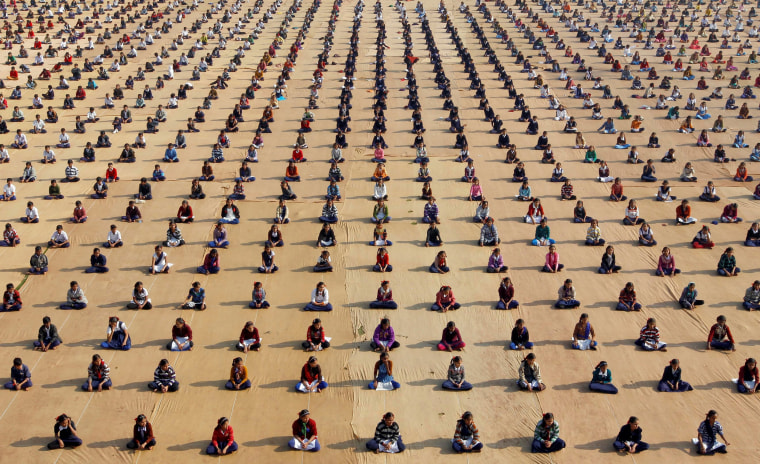 Image: Schoolchildren attend a yoga session at a camp in Ahmedabad