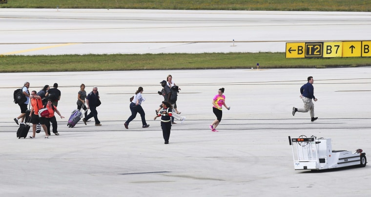 Image: Passengers run on the tarmac at Fort Lauderdale-Hollywood International Airport on Jan. 6.