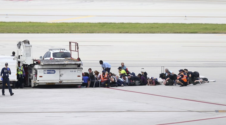 Image: Passengers wait on the tarmac at Fort Lauderdale-Hollywood International Airport on Jan. 6.