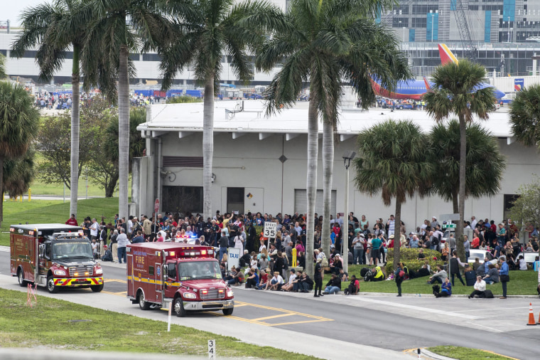 Image: Firemen and ambulances wait outside the Fort Lauderdale airport on Jan. 6.