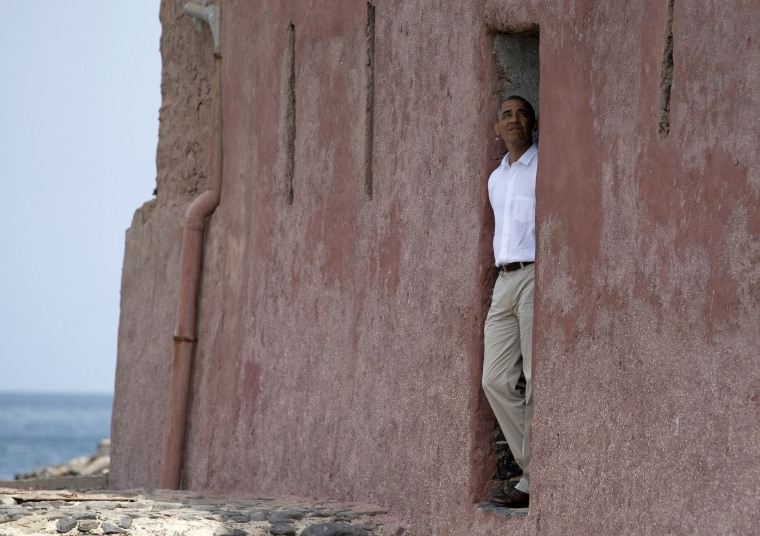 "Image: President Barack Obama looks out of the ""door of no return"" during a tour of Goree Island, Senegal."