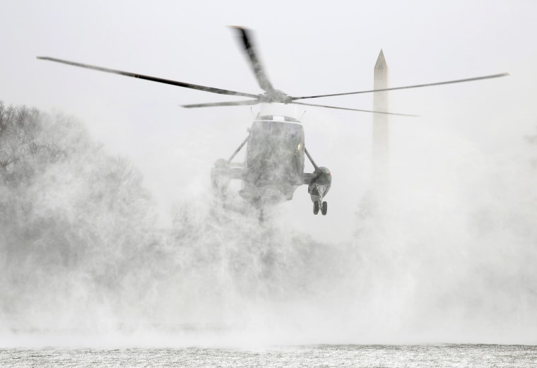 Image: Marine One blows up a cloud of snow as it lands on the South Lawn of the White House in Washington, Jan. 7.