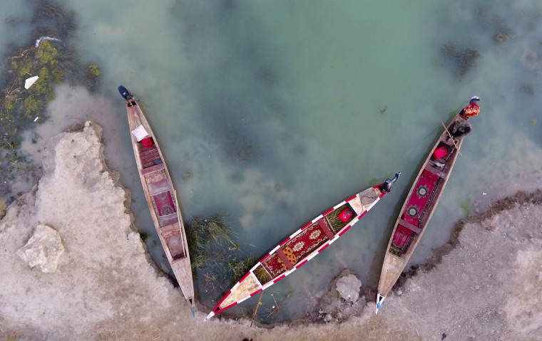 Image: This aerial photo shows boats in the Chabaish marsh in the Maysan province of southern Iraq, Jan. 7.