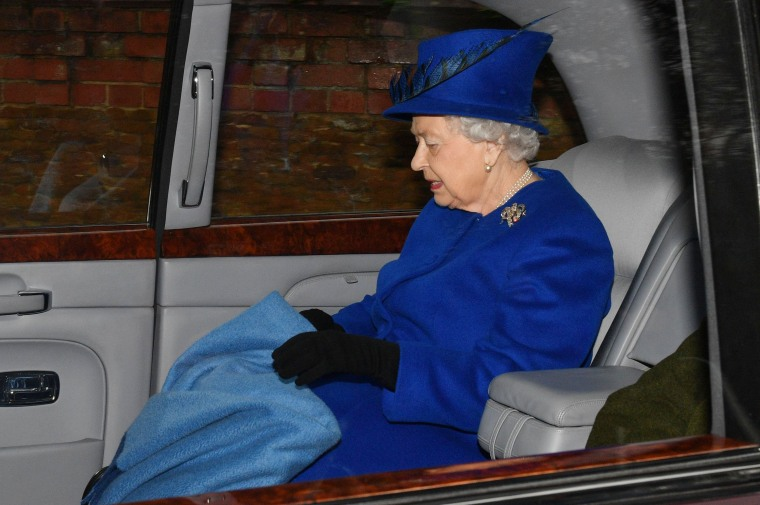 Image: The queen was driven to church, carrying a blanket to keep warm.