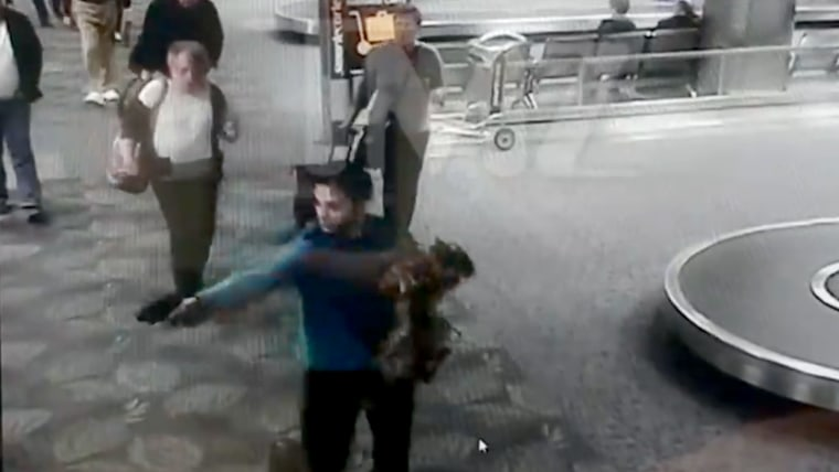 Image: A screengrab of surveillance footage shows Esteban Santiago as he fires his first shots in the baggage claim area of Florida's Ft. Lauderdale International Airport, Jan. 6, 2017.