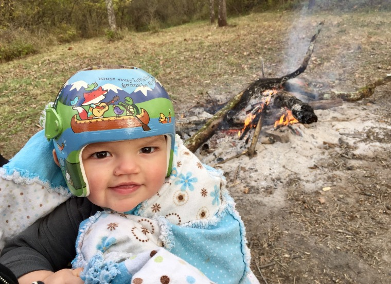 """Amber Botkin chose a camping-themed helmet for her son, Owen, asking that Strawn also include the lyrics to Bob Marley hit """"Three Little Birds"""" in the design. """"Our family is relaxed and laid back, but any time you are dealing with something impacting your children, it can be difficult,"""" said Botkin. """"The helmet is a reminder that everything is going to be alright."""""""