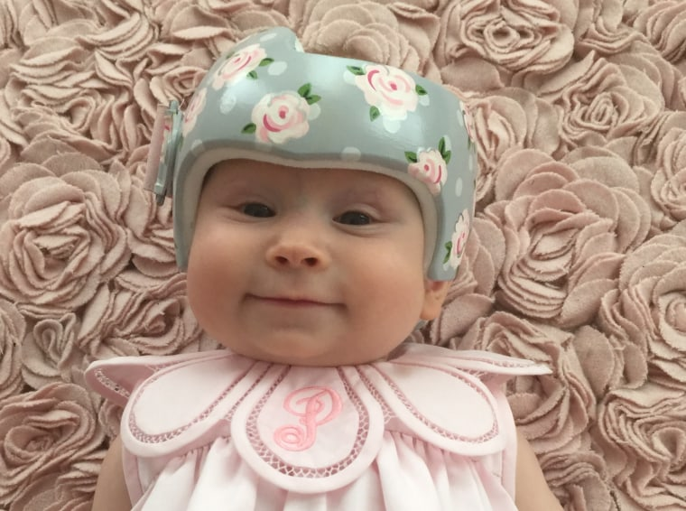 """Regan Luke lives in the south, where """"a proper baby girl rocks a matching bow with every outfit."""" So when her daughter, Piper, needed a corrective helmet, the Texas mom tasked Strawn with creating a masterpiece fit for a girly  girl."""