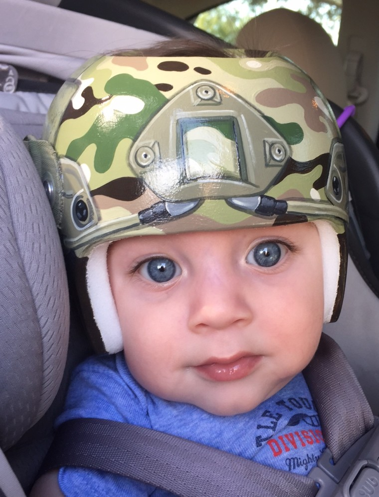 As a nod to her husband's service in the army, Lindsey Menard asked Strawn to paint her son, Levi's, helmet with camouflage.