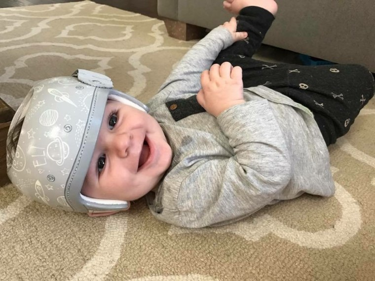 """Stephanie Hanrahan says she struggled with seeing a piece of white plastic strapped to her infant son, Eli's, head. So the Texas mom contacted Strawn for some design help. """"When your child is not the norm, it's easy to submit to helplessness,"""" said Hanrahan. """"Paula has used her beautiful talent to help parents feel empowered."""""""