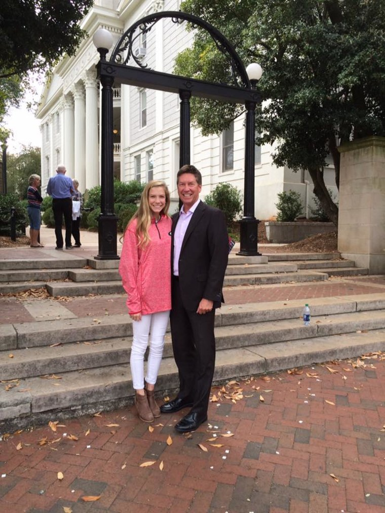 Weatherman Chris Holcomb with his daughter, Claire
