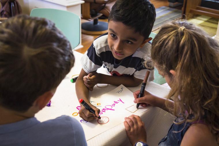 "Kids playing ""entrepreneur"" together"