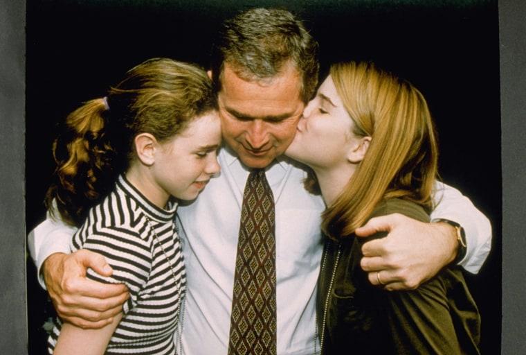 George W. Bush Hugging Daughters