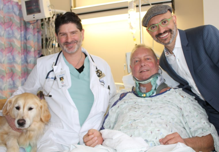 Bob with the doctors who treated him and his dog, Kelsey.