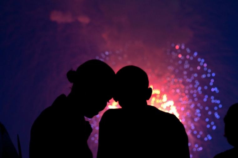 Barack Obama and Michelle Obama watch the fireworks over the National Mall from the roof of the White House, July 4, 2010.