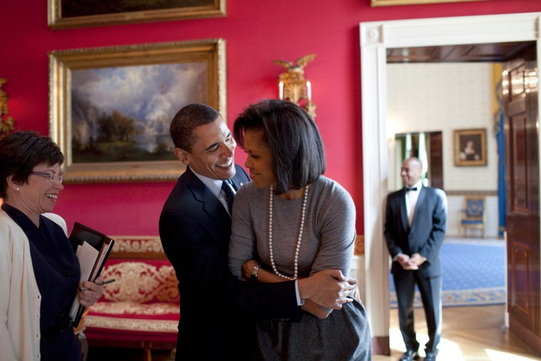 Barack Obama hugs Michelle Obama