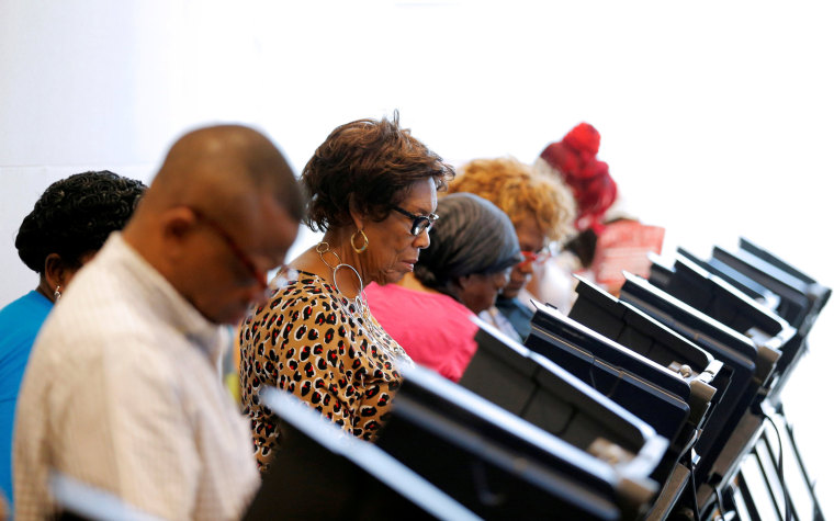 Image: Voters cast their ballots during early voting in Charlotte