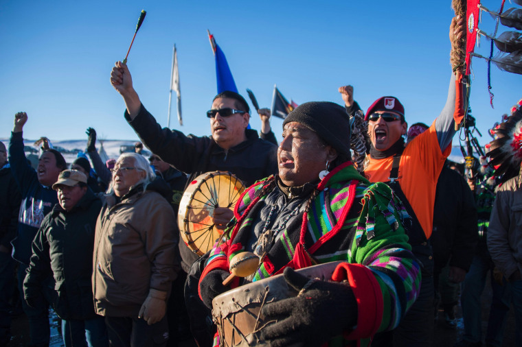 Image: Activists celebrate at Oceti Sakowin Camp on the edge of the Standing Rock Sioux Reservation on Dec. 4, 2016 outside Cannon Ball, North Dakota.