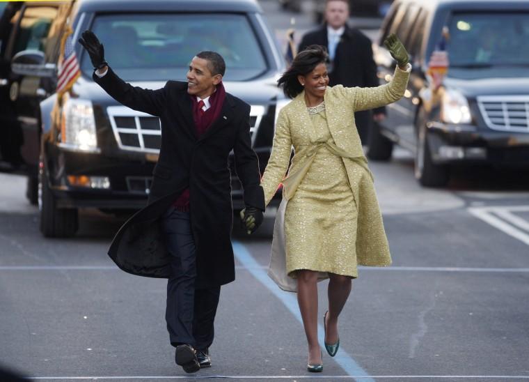 Image: Barack and Michelle Obama walk down Pennsylvania Avenue in Washington